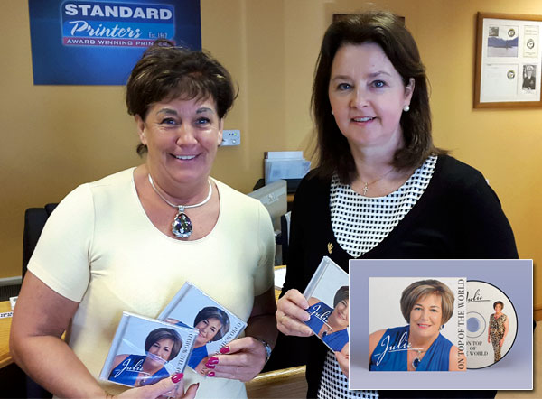 Julie Healy collects her finished CD from Margo Quinn at Standard Printers